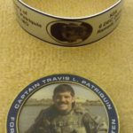 CPT Travis Patriquin Tye Band and Challenge Coin (obverse)